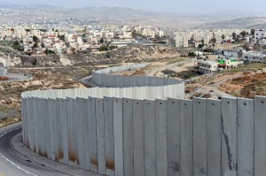 The Israeli separation wall divides the Pisgat Zeev Israeli Settlement, on the left, and the Shuafat Refugee Camp, on the right, outside Jerusalem, January 25, 2011. Al-Jazeera released leaked documents called the
